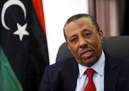 Libya's internationally recognized Prime Minister Abdullah al-Thinni speaks during an interview with Reuters in Bayda