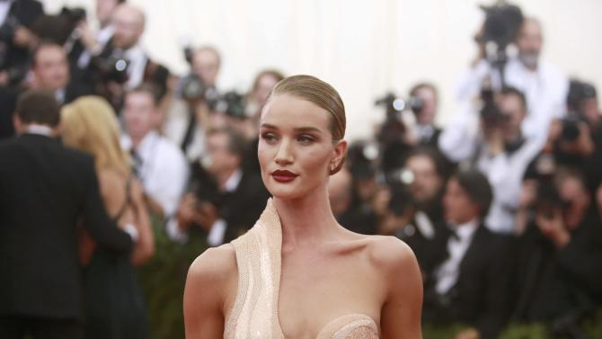 """British model Rosie Huntington-Whiteley arrives for the Metropolitan Museum of Art Costume Institute Gala 2015 celebrating the opening of """"China: Through the Looking Glass,"""" in Manhattan"""