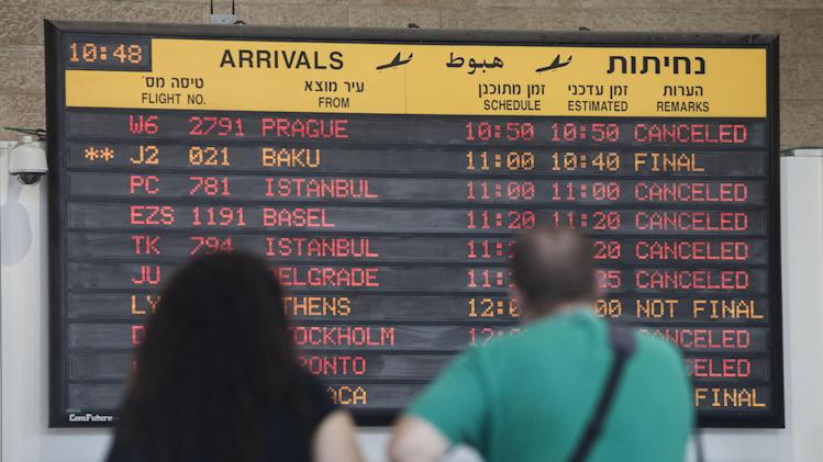 A arrivals flight board displays various canceled and delayed flights in Ben Gurion International airport a day after the U.S. Federal Aviation Administration imposed a 24-hour restriction on flights after a Hamas rocket landed Tuesday within a mile of the airport, in Tel Aviv, Israel, Wednesday, July 23, 2014. U.S. Secretary of State John Kerry flew into Israel's main airport Wednesday despite a Federal Aviation Administration ban in an apparent sign of his determination to achieve a cease-fire agreement in the warring Gaza Strip despite little evidence of progress in ongoing negotiations. (AP Photo/Dan Balilty)