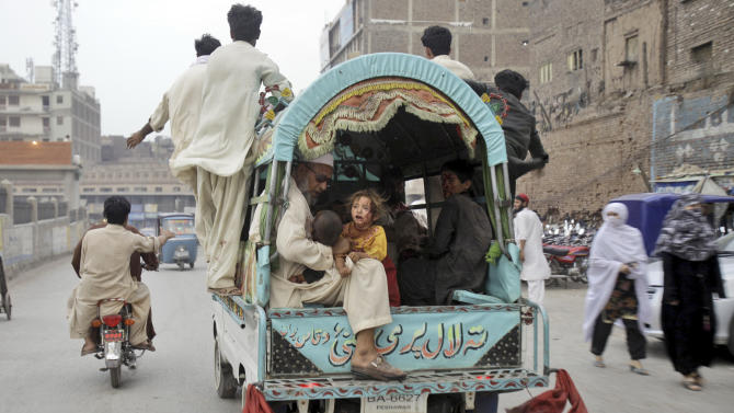 Pakistani children, who were injured in an explosion in a Sunni shrine, are taken in a vehicle to a hospital, in Peshawar, Pakistan, Thursday, June 21, 2012. A Pakistani police officer said that two children have been killed by an explosion at a Sunni shrine in Peshawar as dozens of people gathered there. (AP Photo/Mohammad Sajjad)