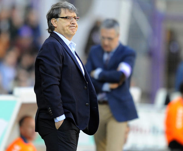 FC Barcelona's coach Gerardo Martino of Argentina watches the Spanish La Liga soccer match against Real Valladolid at the Jose Zorrilla stadium in Valladolid, Spain, Saturday March 8, 2014
