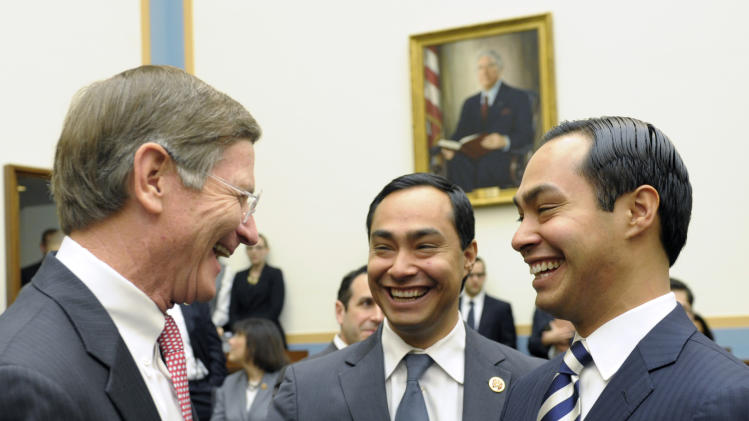 San Antonio, Texas Mayor Julian Castro, right, and his brother Rep. Joaquin Castro, D-Texas, center, talk with House Judiciary Committee member, Rep. Lamar Smith, R-Texas, all from San Antonio, on Capitol Hill in Washington, Tuesday, Feb. 5, 2013, prior to Mayor Castro testifying before the committee's hearing on America's Immigration System: Opportunities for Legal Immigration and Enforcement of Laws against Illegal Immigration.  (AP Photo/Susan Walsh)