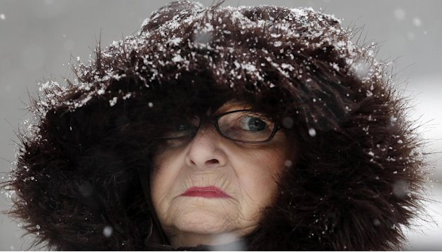 Mary Ann Bova walks along a slippery snow covered sidewalk during a winter storm in Buffalo, N.Y., Friday, Feb. 8, 2013. In some upstate areas, snow fell early Friday morning and was expected to incre