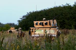 Hungarian soldiers patrol at the border with Serbia…