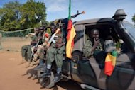 <p>Malian soldiers patrol a street of Diabaly on January 23, 2013. African forces were moving towards Mali's centre Thursday, as pressure grew on Malian troops over summary killings and rights abuses in a French-led assault on Al Qaeda-linked groups</p>