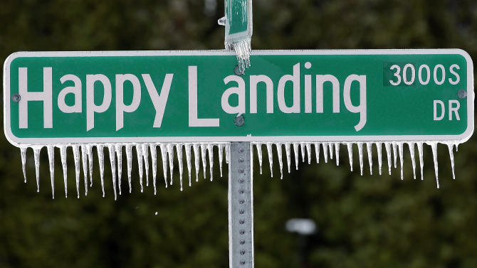 Icicles hang from a street sign after a fast moving snow storm blanketed central Illinois, Friday, Feb. 22, 2013, in Springfield, Ill. Powerful wind gusts created large snow drifts on many roadways, making navigating the slick conditions a challenge. Accidents and slide-offs were reported from Kansas to Michigan as the storm pushed east. (AP Photo/Seth Perlman)