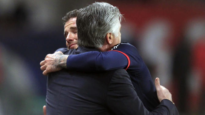 Paris Saint Germain's midfielder David Beckham from England, hugs Paris Saint Germain's coach Carlo Ancelotti, as he leaves the field,  during his French League One soccer match against Brest, at the Parc des Princes stadium, in Paris, Saturday, May 18, 2013. Paris Saint-Germain hopes to strike a deal with David Beckham in the next two weeks in which the former England captain will work with the French club after retirement, possibly in an ambassadorial role. (AP Photo/Thibault Camus)