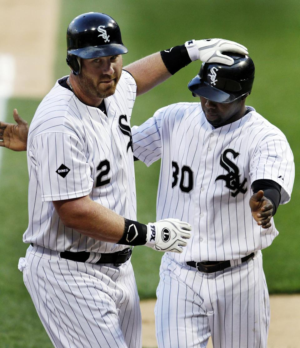 Chicago White Sox's Adam Dunn, left, celebrates with Alejandro De Aza after Dunn hit a two-run home run against the Detroit Tigers during the first inning of a baseball game, Monday, May 14, 2012, in Chicago. (AP Photo/John Smierciak)