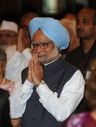 Premier Manmohan Singh forecast on Saturday stronger growth for India&#39;s stumbling economy, prompting opposition charges that the 79-year-old leader was in &quot;denial&quot; mode