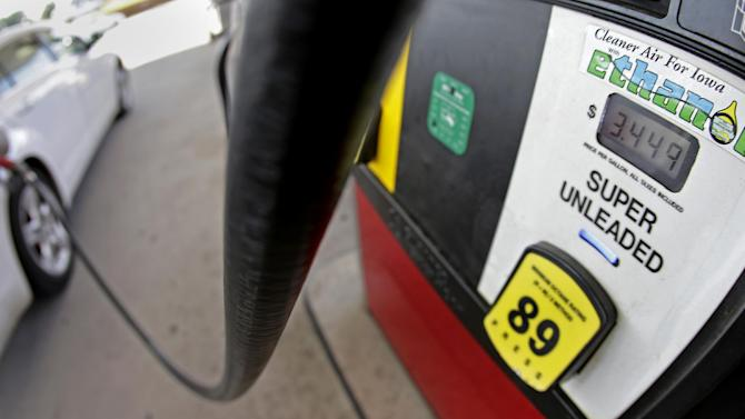 FILE This July 26, 2013 file photo shows a motorist filling up with gasoline containing ethanol in Des Moines. The Obama administration on Friday proposed to reduce the amount of ethanol in the nation's fuel supply for the first time, acknowledging that the biofuel law championed by both parties in 2007 is not working as well as expected.(AP Photo/Charlie Riedel, File)