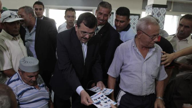 Ali Larayedh, former Tunisian prime minister and leader of the Ennahda Movement Party, campaigns in Tunis