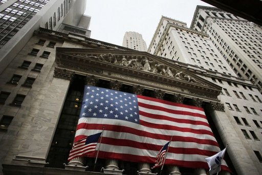 <p>An American flag hangs over the New York Stock Exchange on October 11, in New York City. Americans top the list of favourites for Monday's Nobel Economics Prize, an award that increasingly rarely seems to go to a European.</p>