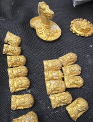 Gold artefacts are seen after they were unearthed from an ancient Thracian tomb near the village of Sveshtari, some 400km (248 miles) north-east of Sofia, November 7, 2012. Bulgarian archaeologists unearthed numerous golden artifacts, including bracelets with snake heads, a tiara and aplications for horse harnesses during excavation works at an ancient Thracian tomb in northern Bulgaria, they said on Thursday. The new golden artifacts are dated back to the end of the fourth or beginning of the third century BC and we found in the biggest of 26 ancient tombs of the Getes, a Thracian tribe that was in contact with the Hellenistic world. Picture taken November 7, 2012.     REUTERS/Emil Iordanov/BGNES (BULGARIA - Tags: SOCIETY) FOR EDITORIAL USE ONLY. NOT FOR SALE FOR MARKETING OR ADVERTISING CAMPAIGNS. BULGARIA OUT. NO COMMERCIAL OR EDITORIAL SALES IN BULGARIA