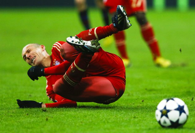 Bayern Munich's Robben falls after being fouled by Arsenal's Rosicky during their Champions League round of 16 second leg match in Munich