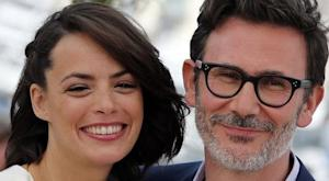 "Director Michel Hazanavicius and cast member Berenice Bejo pose during a photocall for the film ""The Search"" in competition at the 67th Cannes Film Festival"