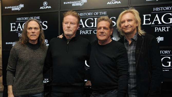 """From left, Timothy B. Schmit, Don Henley, Glenn Frey and Joe Walsh of The Eagles pose together after a news conference at the 2013 Sundance Film Festival, Saturday, Jan. 19, 2013, in Park City, Utah. The documentary film """"The History of The Eagles Part 1"""" is being shown at the festival. (Photo by Chris Pizzello/Invision/AP)"""