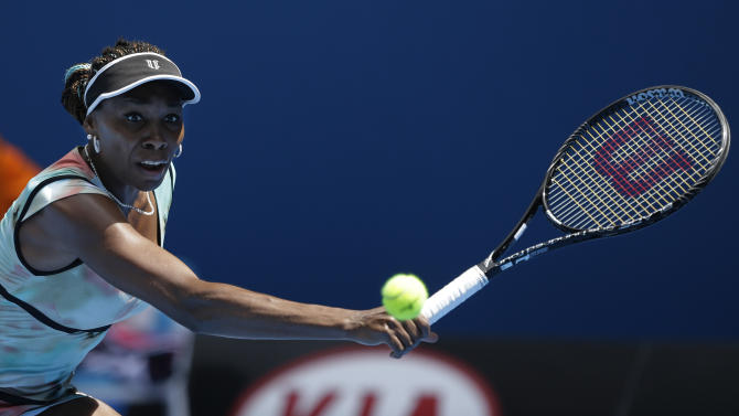 Venus Williams of the US makes a backhand return to Kazakstan's Galina Voskoboeva during their first round match at the Australian Open tennis championship in Melbourne, Australia, Monday, Jan. 14, 2013. (AP Photo/Rob Griffith)