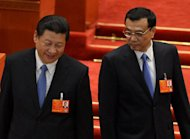 Newly-elected Chinese President Xi Jinping (left) and Premier Li Keqiang arrive to vote during the election of the new vice premiers, foreign and defense ministers during the 12th National People's Congress (NPC) at the Great Hall of the People in Beijing, on March 16, 2013