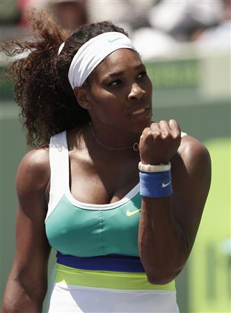 Serena Williams pumps her fist during the women's final of the Sony Open tennis tournament in Key Biscayne, Florida