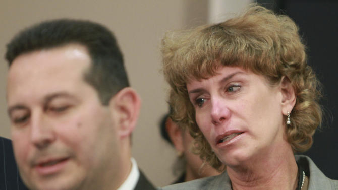 Dorothy Clay Sims cries as she listens to Jose Baez, lead defense counsel for Casey Anthony, talk to the media after his client was found not guilty in Anthony's murder trial in Orlando, Fla., Tuesday, July 5, 2011. Anthony had been charged with killing her daughter, Caylee. (AP Photo/Joe Burbank/Pool)