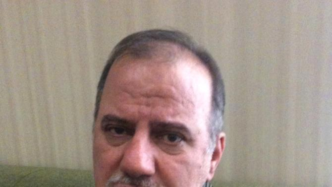 This handout provided by Matthew David Kohn, taken in February 2012 in Los Angeles shows Seyed Mojtaba Atarodi. Arriving at Los Angeles international airport Dec. 7, Atarodi, stepped off of a long flight from Iran expecting to be met by his brother in the arrivals hall. But the 54-year-old microchip scientist, who came to the U.S. in part to seek treatment for a serious heart ailment, was promptly arrested, locked up for almost two months and is now mostly confined to his brother's Los Angeles-area home after posting $460,000 bond.  (AP Photo/Matthew David Kohn)