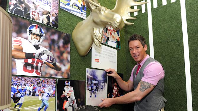 """IMAGE DISTRIBUTED FOR STAPLES - David Bromstad, host of HGTV's """"Color Splash"""", was on hand at Staples' Fifth Avenue, New York City location, Tuesday, May 21, 2013, to showcase home and office spaces he designed using the company's new Staples Sports & Art Photo Gallery.Staples is the first to offer a same-day service of new license photo content which includes the NFL and NBA, as well as art, landscapes and more.(Photo by Diane Bondareff/Invision for Staples/AP Images)"""