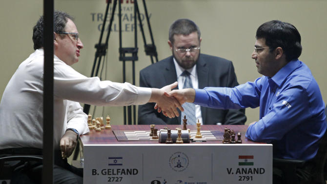 World Chess champion Viswanathan Anand from India, right, shakes hand with Boris Gelfand of Israel after defeating him at the FIDE World Chess Championship tie break match at Moscow's Tretyakovsky State Gallery, Russia, Wednesday,  May 30, 2012. Anand retained his FIDE world champion's title. (AP Photo/Misha Japaridze)