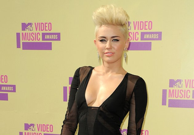 FILE - In this Sept. 6, 2012 file photo, Miley Cyrus attends the MTV Video Music Awards in Los Angeles. A Los Angeles jury convicted Jason Luis Rivera, 40, of trespassing and resisting arrest on Thursday Oct. 11, 2012, roughly a month after he was arrested at the singer&#39;s home. (Photo by Jordan Strauss/Invision/AP, file)