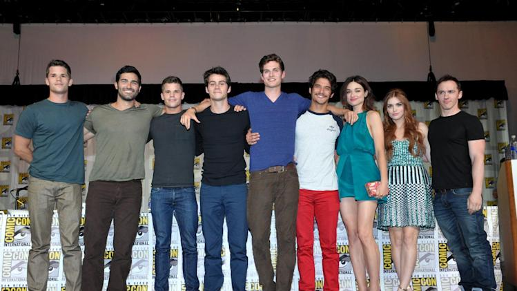 "From left, actors Max Carver, Tyler Hoechlin, Charlie Carver, Dylan O'Brien, Daniel Sharman, Tyler Posey, Crystal Reed, Holland Roden and writer Jeff Davis attend the ""Teen Wolf"" panel at the San Diego Convention Center on Day 2 of Comic-Con International on Thursday, July 18, 2013, in San Diego, Calif. (Photo by John Shearer/Invision for MTV/AP)"