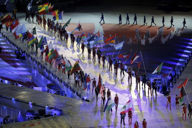 Athletes carry national flags during the closing ceremony of the London 2012 Olympic Games