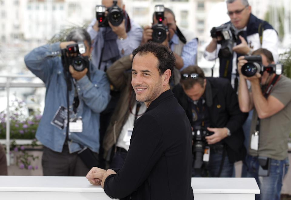 Director Matteo Garrone poses during a photo call for Reality at the 65th international film festival, in Cannes, southern France, Friday, May 18, 2012. (AP Photo/Lionel Cironneau)