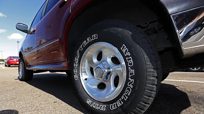 This Tuesday, Oct. 23, 2012 photo, shows a Ford Explorer with Goodyear tires in Jackson, Miss. Goodyear reports earnings, Tuesday, Feb. 12, 2013. (AP Photo/Rogelio V. Solis)