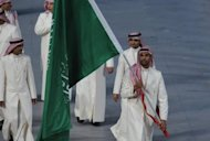 File photo of the Saudi Arabian Olympic team on parade in Beijing in 2008. Saudi Arabia's decision to allow two female athletes to compete at the Olympic Games overturns a decades-old taboo imposed by the conservative Muslim monarchy which still bars women from sports at home