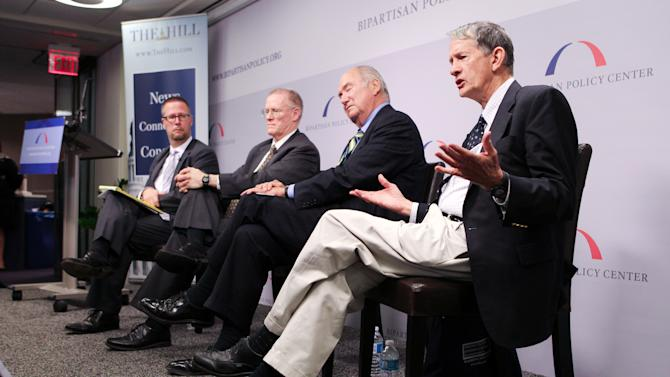 "COMMERCIAL IMAGE - In this photograph taken by AP Images for Peterson Institute for International Economics, Gary Hufbauer, Senior Fellow, Peterson Institute for International Economics, on right, participates in a breakfast panel at the Bipartisan Policy Institute discussing the ""Five Key Issues that Will Decide the Election"" on Thursday, August 2, 2012 in Washington.  (Paul Morigi/AP Images for Peterson Institute for International Economics)."