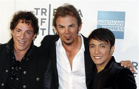 "Singer Arnel Pineda (R), Neal Schon (L) and Jonathan Cain of the band Journey arrive for the premiere of ""Don't Stop Believin': Everyman's Journey"" during the 2012 Tribeca Film Festival in New York, April 19, 2012. REUTERS/Lucas Jackson"