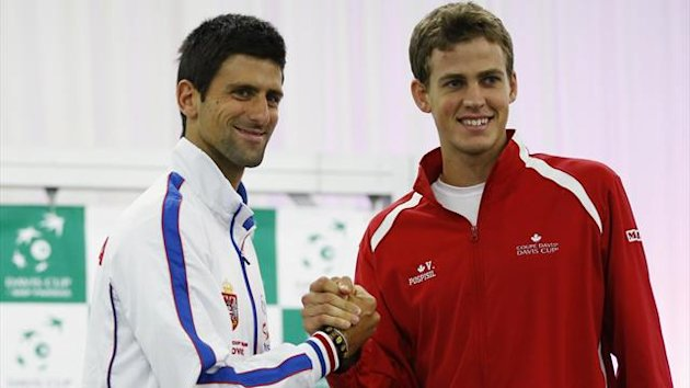 Serbia's Novak Djokovic (L) and Canada's Vasek Pospisil shake hands after the draw for the Davis Cup semi-finals in Belgrade (Reuters)