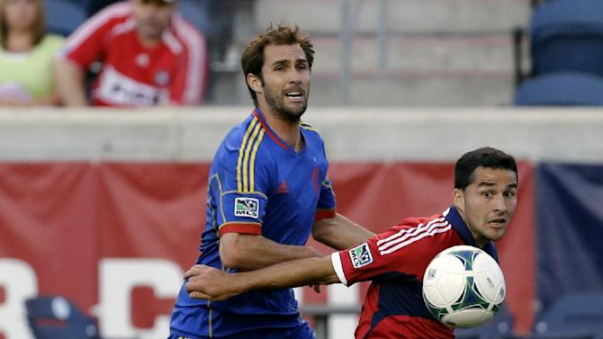 Colorado Rapids defender Brian Mullan, left, and Chicago Fire midfielder Dilly Duka battle as they watch the ball during the first half of an MLS soccer match in Bridgeview, Ill., Wednesday, June 19, 2013. The Fire won 2-1