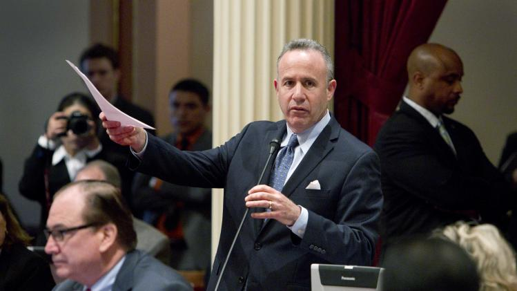 California Senate President Pro Tem Darrell Steinberg, D-Sacramento, introduces a resolution to suspend three Democrats who face charges in criminal cases on the floor of the Senate in Sacramento, Calif., on Friday, March 28, 2014. The resolution, which passed 28-1, prevents Democratic Sens. Ron Calderon, Leland Yee and Rod Wright from exercising any power of their office until the pending criminal cases against them have been resolved.(AP Photo/Steve Yeater)