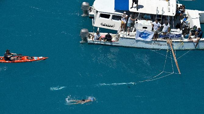 In this photo provided by the Florida Keys News Bureau, Diana Nyad, positioned about two miles off Key West, Fla., Monday, Sept. 2, 2013, swims towards the completion of her approximately 110-mile trek from Cuba to the Florida Keys. Nyad, 64, is the first swimmer to cross the Florida Straits without the security of a shark cage. (AP Photo/Florida Keys News Bureau, Andy Newman)