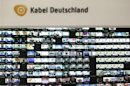 The logo of Kabel Deutschland is pictured above a monitor wall at the Kabel Deutschland playout center in Frankfurt