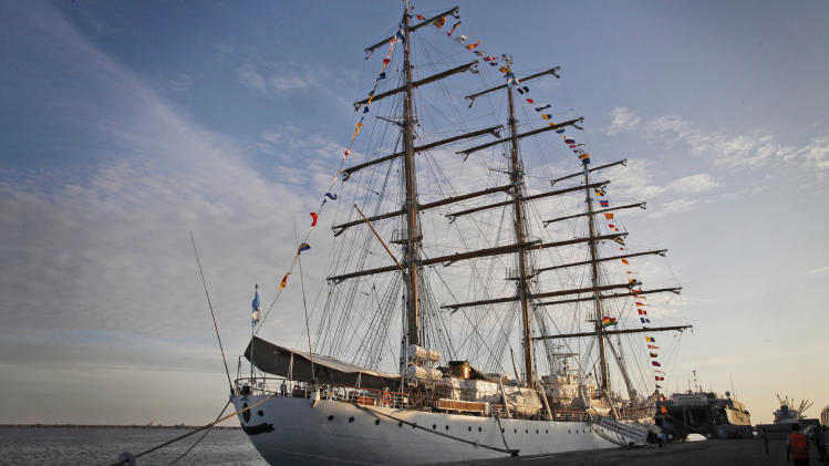 The three-masted ARA Libertad, sits docked at the port in Tema, outside Accra, Ghana, Saturday, Oct. 20, 2012. Argentina announced the immediate evacuation Saturday of about 300 crew members from the Libertad, a navy training ship seized in Africa nearly three weeks ago as collateral for unpaid bonds dating from the South American nation's economic crisis a decade ago.(AP Photo/Gabriela Barnuevo)