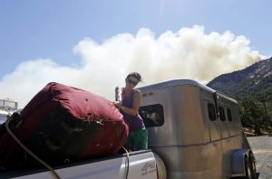 Heather Seeno loads equipment onto a truck at Ranch…