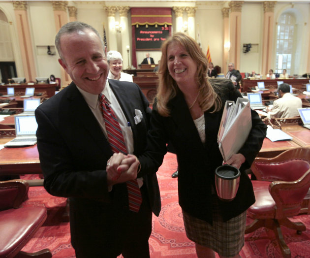 Senate President Pro Tem Darrell Steinberg, D-Sacramento, and Sen. Noreen Evans, D-Santa Rosa, smile as they leave the Senate after lawmakers approved the last of the budget-related bills at the Capit