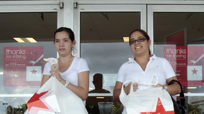 FILE - In this Sept, 29, 2011, file photo, Elsy Santiago, left, and her sister Betsy, exit a Macy's in Hialeah, Fla.  Macy's Inc. said Wednesday, May 9, 2012, that its net income rose to $181 million, or 43 cents per share, for the three-month period ended April 28. (AP Photo/Alan Diaz, File)