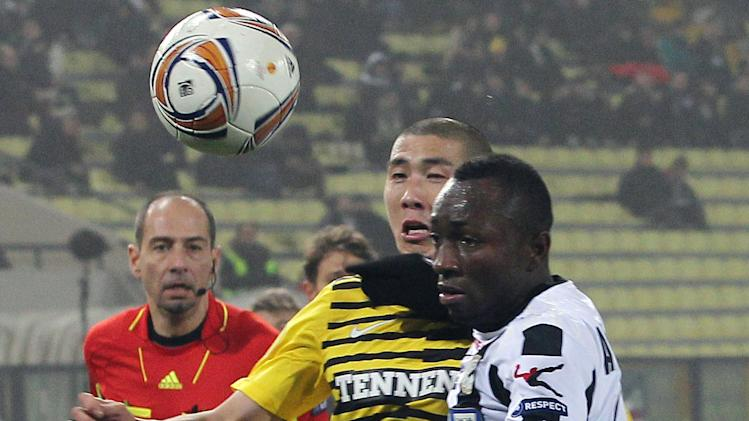 Udinese's Pablo Armero,right, of Colombia, and Celtic's Cha Du-Ri, of Korea, fight for the ball during their Europa League, group I soccer match between Udinese and Celtic FC, at the Udine Friuli stadium, Italy, Thursday, Dec. 15, 2011. (AP Photo/Paolo Giovannini)