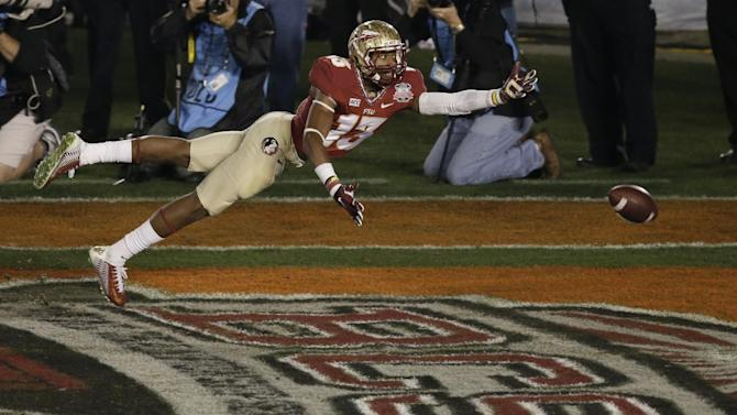 Florida State's Jalen Ramsey can't quite intercept a pass during the second half of the NCAA BCS National Championship college football game against Auburn Monday, Jan. 6, 2014, in Pasadena, Calif