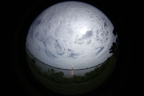 The launch of space shuttle Atlantis, seen in a fisheye view from the Kennedy Space Center press sit