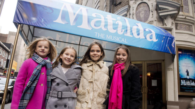 "FILE - This Nov. 15, 2012 file photo shows, from left, Milly Shapiro, Sophia Gennusa, Oona Laurence and Bailey Ryon, the four actresses who share the starring role in ""Matilda the Musical"" on Broadway, outside the Shubert Theatre in New York. The administration committee for the awards met Friday for the fourth and final time to determine the eligibility of certain shows and ruled that the qurtet of actresses who rotate as the lead in ""Matilda"" are not eligible in the category of Best Performance by an Actress in a Musical category. (Photo by Charles Sykes/Invision/AP, file)"