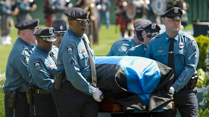 Thousands attend memorial service for slain MIT police officer