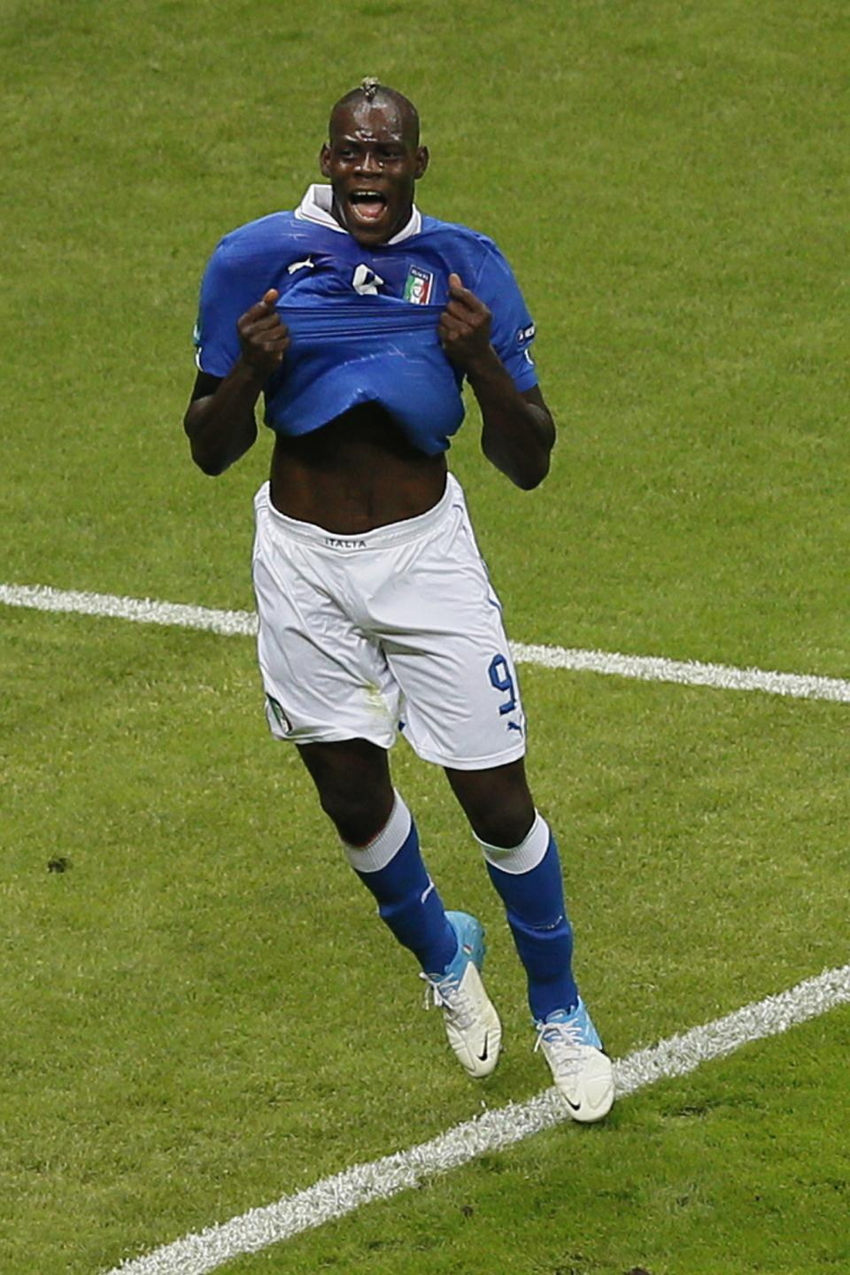 Italy's Mario Balotelli celebrates scoring the opening goal during the Euro 2012 soccer championship semifinal match between Germany and Italy in Warsaw, Poland, Thursday, June 28, 2012. (AP Photo/Vadim Ghirda)